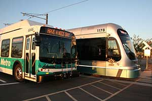 Bus and light rail at sunset
