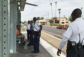 Fare inspectors and police assistants questioning riders who did not have valid fare during a fare sweep.