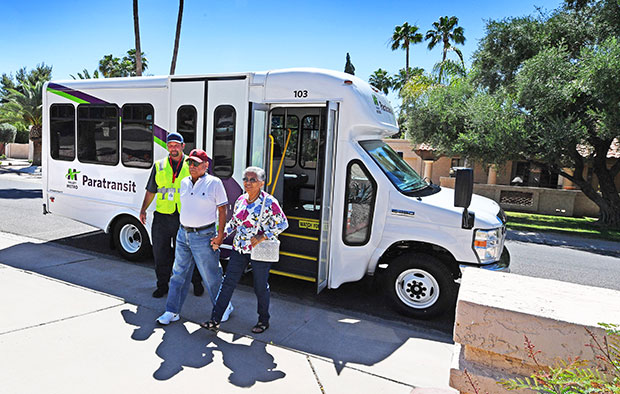 A couple exiting a paratransit vehicle
