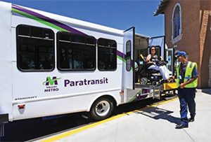 Image of a woman in a wheelchair boarding a van