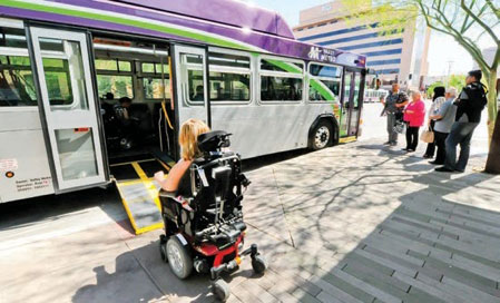 Image of a woman boarding a bus in a wheelchair