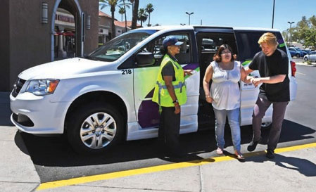 Image of a woman exiting a paratransit vehicle