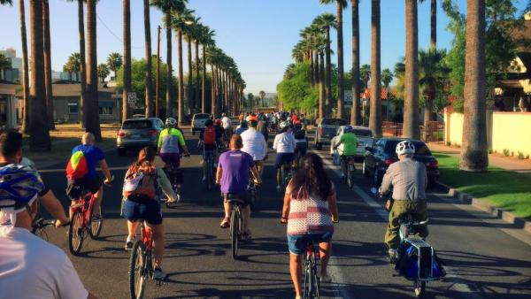 Group of people bicycling in downtown Phoenix