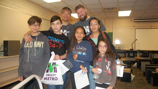 Family posing with Valley Metro IT staff.