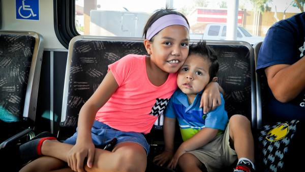 Kids riding Valley Metro bus