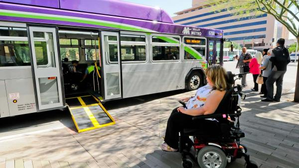 Rider in wheelchair getting ready to board Valley Metro Bus