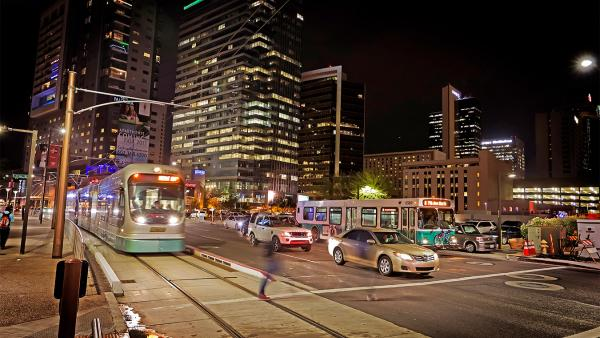 Valley Metro bus and light rail driving through downtown phoenix at night