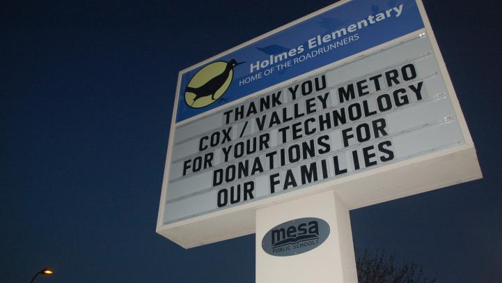 School sign thanking Valley Metro and Cox for donating computers to its families