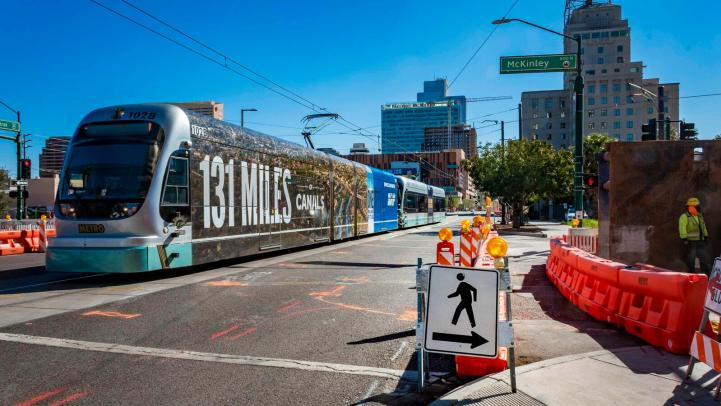 Light rail going through construction zone on Central Avenue and McKinley Street in Downtown Phoenix.