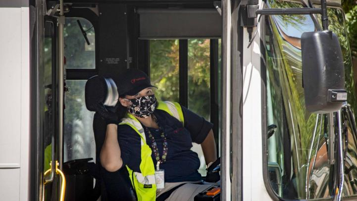 Bus operator wearing face covering