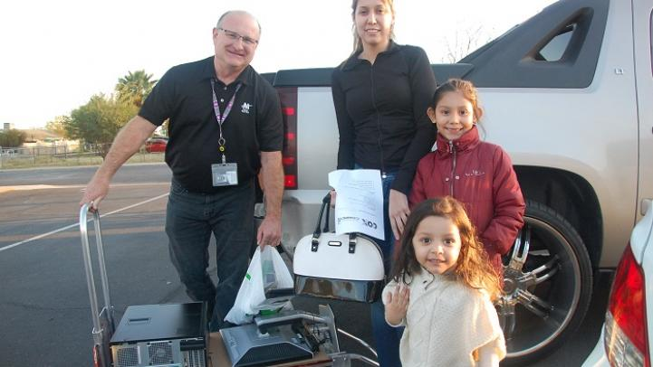 Valley Metro IT staff drops off donated computer tech.