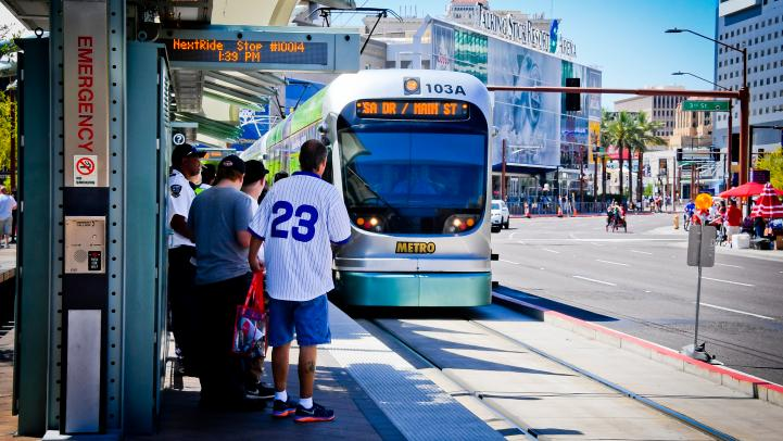 Baseball fans waiting for light rail to arrive