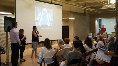 Cheryle Marine, Valley Metro's Public Art Specialist, speaks to August 8 public meeting attendees about the project's public art components.