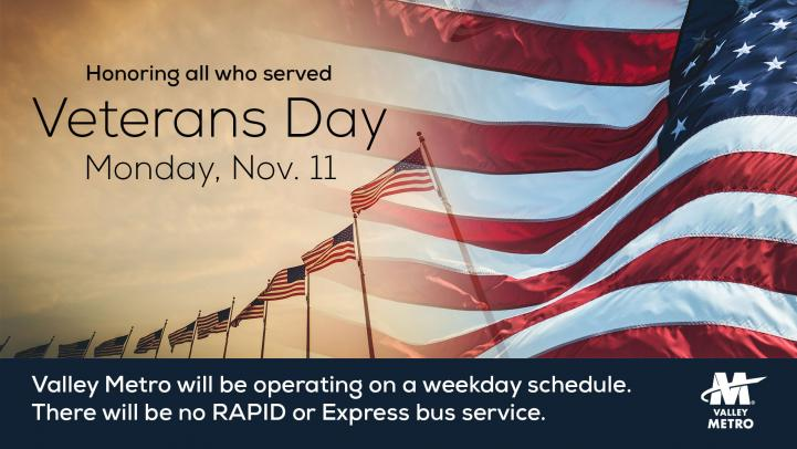 """a row of american flags, text reads """"honoring all who served Veterans Day Monday November 11."""""""