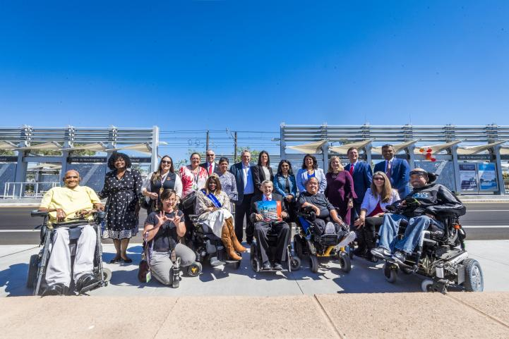 A group of riders gather to celebrate the 50th Street Station opening
