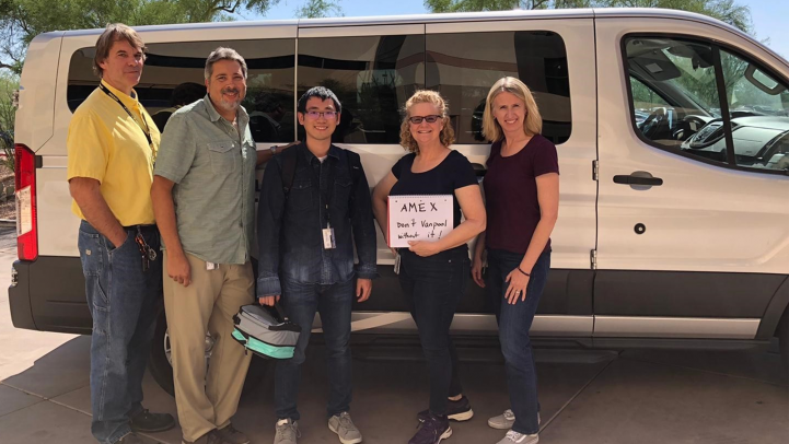 American Express employees standing by their van