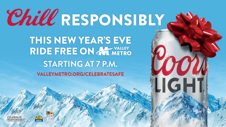 Chill responsibly. This New Year's Eve ride free on Valley Metro starting at 7 p.m. Coors light beer can with red ribbon on top in front of snowy mountains.