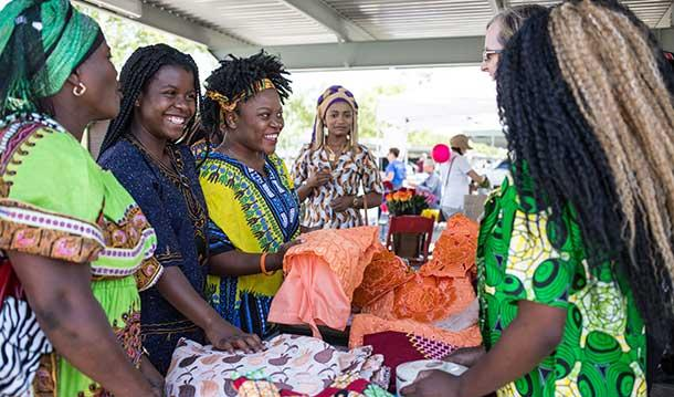 Group of smiling women with colorful clothes at the World Bazaar