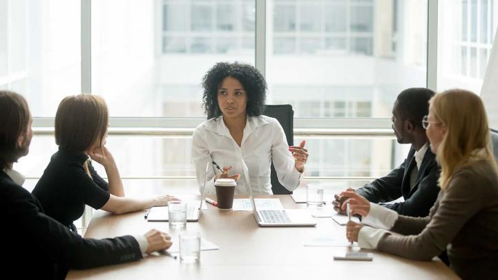 Professional people sitting at conference table