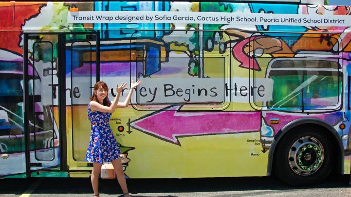 Design a Transit Wrap winner standing next to the bus