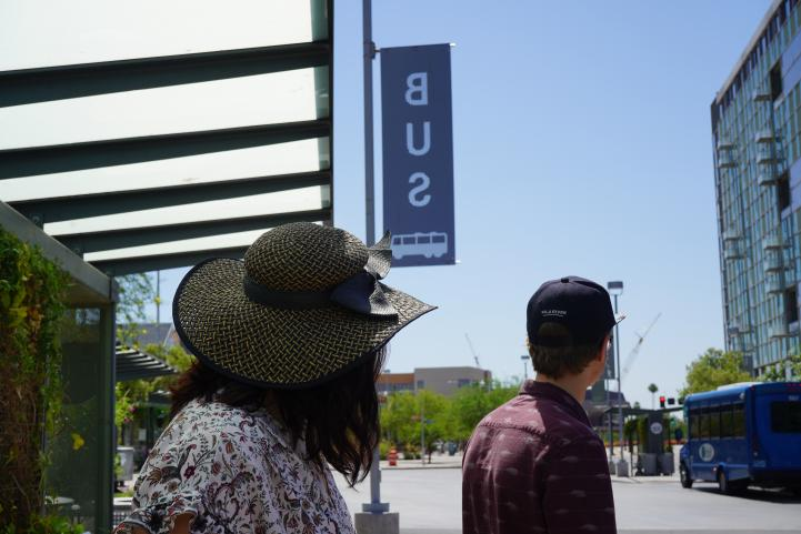 hats on bus sign