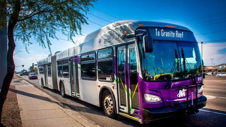 Articulated bus in purple and silver