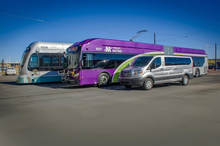Picture of vanpool, bus and light rail train.