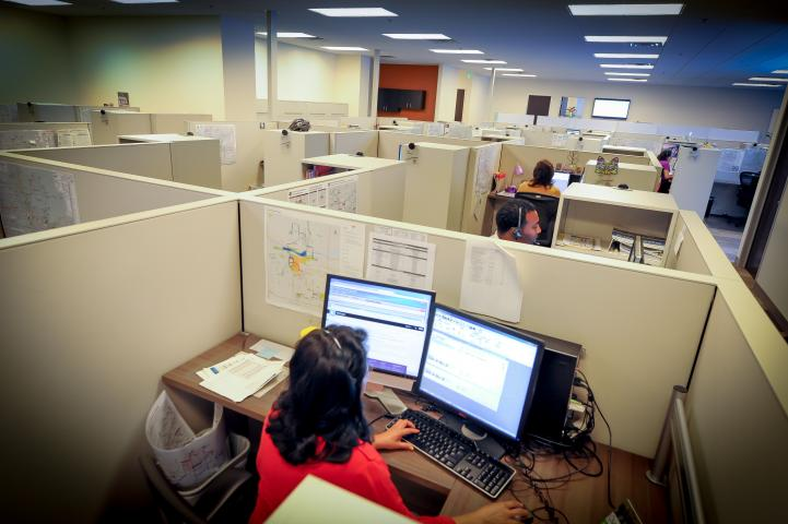 Customer Service reps at the Valley Metro call center assisting customers.