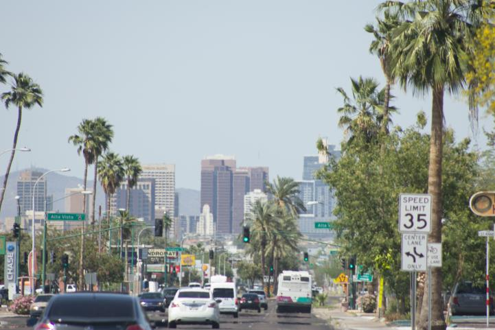 South Central streets with downtown skyline.