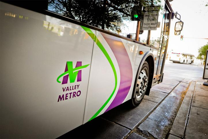 side of a bus with Valley Metro logo