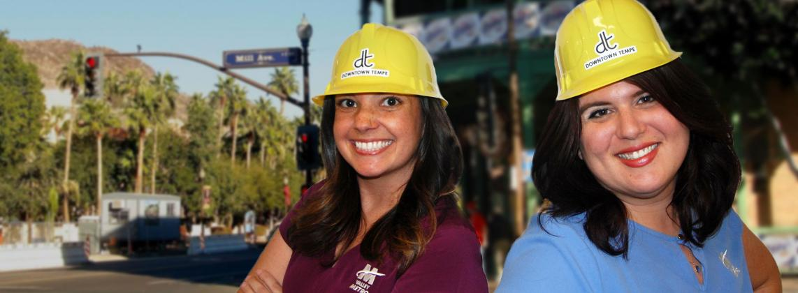 Young ladies wearing hard hats smiling