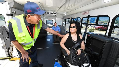 Accessibility Services Operator with Customer on Bus