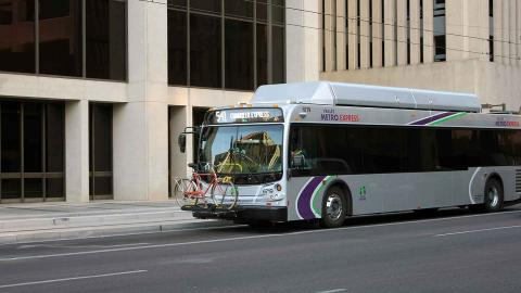Express bus traveling through downtown Phoenix