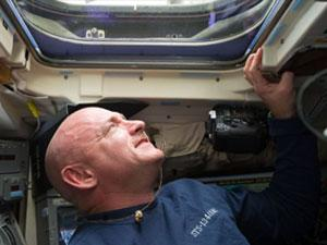 Mark Kelly looking up through space station window
