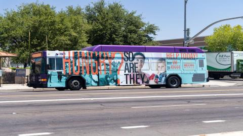 The specially-wrapped Summer of a Million Meals bus.
