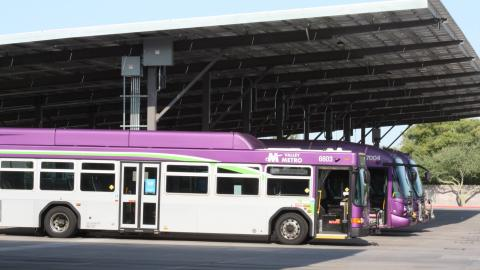Buses parked under solar canopy