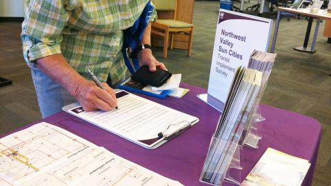 Sun City resident completes a survey on a Valley Metro table.