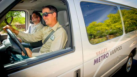 Desert Mountain employees riding in a vanpool vehicle