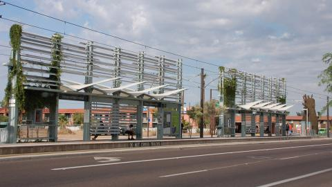riders wait at the Dorsey/Apache rail station