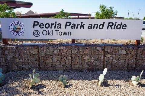 "The sign in front of the Peoria park-and-ride that reads: ""Peoria Park and Ride @ Old Town."""