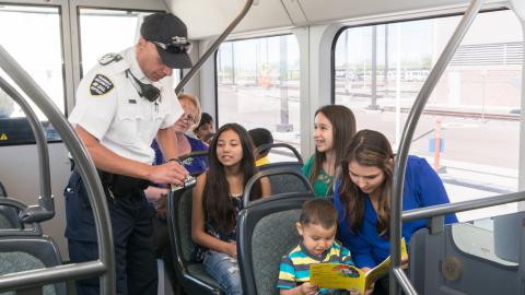 Fare inspector checking tickets on light rail