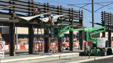 crew building the light rail laying down tracks