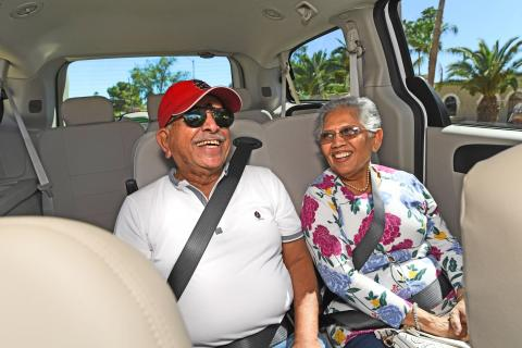happy senior couple taking a ride in a ridechoice vehicle