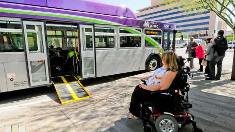 Rider in wheelchair boarding a Valley Metro bus