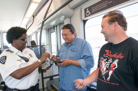 Valley Metro Fare Inspector on train