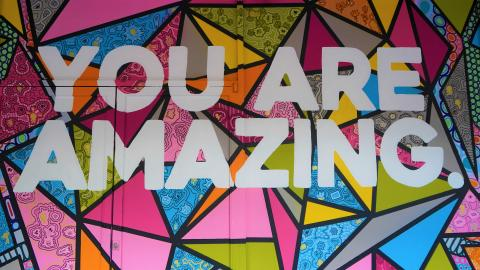 Text: You Are Amazing. Geometric shapes filled with bright vibrant colors