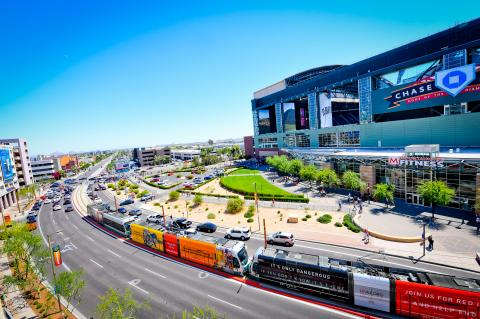 Light rail train passes by Chase Field
